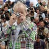 Photo -   Actor Bill Murray plays with a camera during a photo call for Moonrise Kingdom at the 65th international film festival, in Cannes, southern France, Wednesday, May 16, 2012. (AP Photo/Joel Ryan)