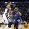 Oklahoma City\'s Russell Westbrook (0) tries to get around Memphis\' Courtney Lee (5) during Game 6 in the first round of the NBA playoffs between the Oklahoma City Thunder and the Memphis Grizzlies at FedExForum in Memphis, Tenn., Thursday, May 1, 2014. Photo by Bryan Terry, The Oklahoman