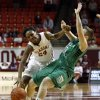 Oklahoma\'s Sharane Campbell (24) is fouled on a drive by Hannah Christian (00) as the University of Oklahoma Sooners (OU) play the North Texas Mean Green in NCAA, women\'s college basketball at The Lloyd Noble Center on Thursday, Dec. 6, 2012 in Norman, Okla. Photo by Steve Sisney, The Oklahoman