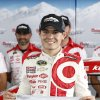 Photo - Kyle Larson poses with the pole award after qualifying in first position for Sunday's NASCAR Sprint Cup Series auto race at Pocono Raceway, Friday, Aug. 1, 2014, in Long Pond, Pa. (AP Photo/Matt Slocum)