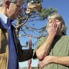 Gov. Brad Henry talks with Sue Rose while surveying damage at the Bar K Mobile Home Park in Lone Grove, Okla., Wednesday, February 11, 2009. On Tuesday, February 10, 2009, a tornado moved through Lone Grove killing at least eight people. Rose was unable to seek shelter in time to avoid the tornado and rode out the storm in a mobile home with four other people. The mobile home was damaged, however, the people survived. BY NATE BILLINGS, THE OKLAHOMAN