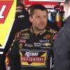 Driver Tony Stewart talks with a crew member in the garage after practice for Sunday\'s NASCAR Sprint Cup auto race at Martinsville Speedway in Martinsville, Va. Saturday April 6, 2013. (AP Photo/Steve Sheppard)