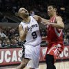 San Antonio Spurs\' Tony Parker (9), of France, loses control of the ball as he is fouled by Houston Rockets\' Jeremy Lin, right, during the first quarter of an NBA basketball game on Friday, Dec. 28, 2012, in San Antonio. (AP Photo/Eric Gay)