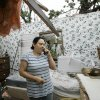 Yolanda Suarez talks on her cell phone in what is left of the bedroom of her mobile home Tuesday in Seminole. Several tornadoes swept through Oklahoma on Monday, leaving a path of destruction, including Suarezs home. AP Photo