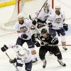 Oklahoma City\'s Hunter Tremblay (36) controls the puck in front of San Antonio\'s James Wright (28) and Oklahoma City teammates Taylor Chorney (4), left, Bryan Helmer (20), right, and goalie Yann Danis (35) during Game 1 in the second round of the AHL hockey playoffs between the Oklahoma City Barons and the San Antonio Rampage at the Cox Convention Center in Oklahoma City, Thursday, May 3, 2012. Photo by Nate Billings, The Oklahoman