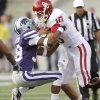 Oklahoma Sooners\' Blake Bell (10) hits Kansas State Wildcats\' Matthew Pearson (38) on a run during the college football game between the University of Oklahoma Sooners (OU) and the Kansas State University Wildcats (KSU) at Bill Snyder Family Stadium on Saturday, Oct. 29, 2011. in Manhattan, Kan. Photo by Chris Landsberger, The Oklahoman ORG XMIT: KOD