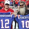 Photo - Terry Bradshaw and Phil Robertson, who both played at quarterback for Louisiana Tech in the 1960s, hold jerseys on the field at an NCAA college football game between Louisiana Tech and Tulane on Thursday, Sept. 12, 2013, in Ruston, La. (AP Photo/The News-Star, Dacia Idom) NO SALES