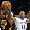 Photo - Kentucky's DeNesha Stallworth (11) and Central Michigan's Crystal Bradford (23) fight for a rebound during the first half of an NCAA basketball game, Sunday, Nov. 17, 2013, in Lexington, Ky. (AP Photo/James Crisp)