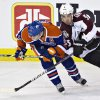 Colorado Avalanche\'s Shane O\'Brien and Edmonton Oilers\' Jordan Eberle battle for the puck during the first period of their NHL hockey game, Monday, Jan. 28, 2013, in Edmonton, Alberta. (AP Photo/The Canadian Press, Jason Franson)