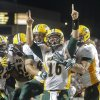 North Dakota State\'s quarterback Brock Jensen lets out a scream as his teammates rejoice with him after scoring with 28 seconds left in the fourth quarter, putting the Bison ahead 23-21, during an NCAA college football game in Manhattan, Kan., Friday, Aug. 30, 2013. North Dakota State upset Kansas State 24-21. (AP Photo/The Topeka Capital Journal, Chris Neal)