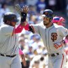 Photo - San Francisco Giants' Pablo Sandoval, left, congratulates Brandon Hicks for hitting a two-run home run in the seventh inning of a baseball game against the Los Angeles Dodgers on Sunday, May 11, 2014, in Los Angeles. (AP Photo/Alex Gallardo)