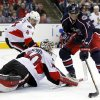 Photo - Columbus Blue Jackets' Marian Gaborik, right, of Slovakia handles the puck against Ottawa Senators goalie Robin Lehner (40) of Sweden and Chris Phillips (4) in the second period of an NHL hockey game in Columbus, Ohio, Tuesday, Nov. 5, 2013. (AP Photo/Paul Vernon)