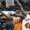 Phoenix Suns center Jermaine O\'Neal, left, drives to the basket against Chicago Bulls center Nazr Mohammed during the first half of an NBA basketball game in Chicago on Saturday, Jan. 12, 2013. (AP Photo/Nam Y. Huh)