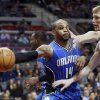Photo - Orlando Magic guard Jameer Nelson (14) passes against Detroit Pistons forward Kyle Singler during the first half of an NBA basketball game Tuesday, Jan. 22, 2013, in Detroit. (AP Photo/Duane Burleson)