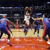 Photo - Chicago Bulls guard Nate Robinson (2) shoots between Detroit Pistons forwards Charlie Villanueva (31) and Austin Daye (5) during the first half of an NBA basketball game, Wednesday, Jan. 23, 2013, in Chicago. (AP Photo/Charles Rex Arbogast)