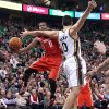 Photo - Houston Rockets' Aaron Brooks, left, goes to the basket as Utah Jazz's Enes Kanter (0) defends in the second quarter of an NBA basketball game Monday, Dec. 2, 2013, in Salt Lake City. (AP Photo/Rick Bowmer)