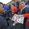 Oklahoma State student Tiffany Kasai sells Bedlam programs before the Bedlam college football game between the Oklahoma State University Cowboys (OSU) and the University of Oklahoma Sooners (OU) at Boone Pickens Stadium in Stillwater, Okla., Saturday, Dec. 3, 2011. Photo by Chris Landsberger, The Oklahoman
