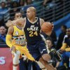 Photo - Utah Jazz forward Richard Jefferson, front, works inside for a shot past Denver Nuggets guard Randy Foye in the first quarter of an NBA basketball game in Denver on Saturday, April 12, 2014. (AP Photo/David Zalubowski)