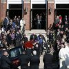 Photo - Mourners line the steps of St. Augustine Church in Andover, Mass., Monday Oct. 28, 2013, as the casket of slain Danvers High School teacher Colleen Ritzer is carried out from her funeral Mass into a hearse. (AP Photo/Elise Amendola)