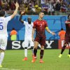 Photo - Portugal's Cristiano Ronaldo, center, and Portugal's Bruno Alves, right, react to a play along with United States' Matt Besler, left, and United States' DaMarcus Beasley, second from left, during the group G World Cup soccer match between the USA and Portugal at the Arena da Amazonia in Manaus, Brazil, Sunday, June 22, 2014. (AP Photo/Paulo Duarte)