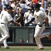Photo - San Francisco Giants left fielder Michael Morse, right, is congratulated by third base coach Tim Flannery (1) after hitting a solo home run off of Atlanta Braves pitcher Alex Wood during the sixth inning of a baseball game in San Francisco, Wednesday, May 14, 2014. (AP Photo)