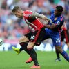 Photo - Manchester United's Antonio Valencia, right, vies for the ball with Sunderland's Connor Whickham, left, during their English Premier League soccer match at the Stadium of Light, Sunderland, England, Sunday, Aug. 24, 2014. (AP Photo/Scott Heppell)