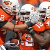 CELEBRATION: Oklahoma State\'s Justin Gent (42), Johnny Thomas (12) and Orie Lemon (41) celebrate after Thomas\' interception during the college football game between the Oklahoma State University Cowboys (OSU) and the Baylor University Bears at Boone Pickens Stadium in Stillwater, Okla., Saturday, Nov. 6, 2010. Photo by Chris Landsberger, The Oklahoman