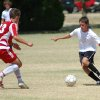 ESC 90 Chris Wilson (in white) puts a move on a TSC player Saturday during the Beat the Heat Soccer Tournament in Edmond, OK Community Photo By: Jeff Wilson Submitted By: Jeff, Edmond