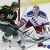 Photo - A scoring attempt by Minnesota Wild's Mikael Granlund, left, of Finland, is broken up as New York Rangers goalie Cam Talbot defends the net in the first period of an NHL hockey game on Thursday, March 13, 2014, in St. Paul, Minn. (AP Photo/Jim Mone)