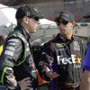 Photo - Denny Hamlin, right, the talks with Kyle Busch in the garage area after taking the pole position in his FedEx Express Toyota for the NASCAR Sprint Cup series Auto Club 400 auto race in Fontana, Calif., Friday, March 22, 2013. (AP Photo/Reed Saxon)