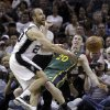 San Antonio Spurs\' Manu Ginobili, left, of Argentina, and Utah Jazz\'s Gordon Hayward (20) reach for a loose ball during the second quarter of Game 2 of a first-round NBA basketball playoff series, Wednesday, May 2, 2012, in San Antonio. (AP Photo/Eric Gay)
