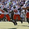 Oklahoma State\'s Johnny Thomas (12) returns an interception for a touchdown during the second half of the college football game between the Oklahoma State University Cowboys (OSU) and the Kansas State University Wildcats (KSU) on Saturday, Oct. 30, 2010, in Manhattan, Kan. Photo by Chris Landsberger, The Oklahoman