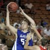 The East\'s C. J. Cole shoots over the West\'s Rhett Radcliff during the All State Small School Boys Basketball game at Oral Roberts University in Tulsa, OK, July 26, 2012. MICHAEL WYKE/Tulsa World