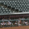 The Oklahoma State team waits in the dugout during a rain delay in a Big 12 Tournament baseball game between Oklahoma State University and the University of Texas at Chickasaw Bricktown Ballpark in Oklahoma City, Saturday, May 24, 2014. Photo by Bryan Terry The Oklahoman