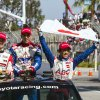 From left, Graham Rahal (15), Justin Wilson (19), of England, and Takuma Sato (14), of Japan, wave to fans as they take their victory lap after the IndyCar Series Grand Prix of Long Beach auto race, Sunday, April 21, 2013, in Long Beach, Calif. Sato took first, Rahal second and Wilson third. (AP Photo/Ringo H.W. Chiu)