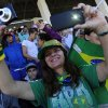 Photo - A soccer fan on the stands uses her camera and mobile device to capture Portugal's training session, in Campinas, Brazil, Thursday, June 12, 2014. Portugal plays in group G of the Brazil 2014 soccer World Cup. (AP Photo/Paulo Duarte)