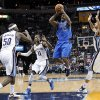 Dallas Mavericks guard Mike James (13) goes to the basket against Memphis Grizzlies\' Zach Randolph (50), Mike Conley (11) and Austin Daye (5) during the first half of an NBA basketball game Wednesday, Feb. 27, 2013, in Memphis, Tenn. (AP Photo/Lance Murphey)