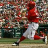 Photo -   Washington Nationals' Bryce Harper hits a solo home run during the fifth inning of a baseball game against the Miami Marlins at Nationals Park Saturday, Sept. 8, 2012, in Washington. (AP Photo/Alex Brandon)
