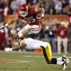 Oklahoma\'s Trey Millard (33) leaps over Iowa\'s Jordan Bernstine (4) during the Insight Bowl college football game between the University of Oklahoma (OU) Sooners and the Iowa Hawkeyes at Sun Devil Stadium in Tempe, Ariz., Friday, Dec. 30, 2011. Photo by Bryan Terry, The Oklahoman