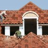 Mundo Reyas, left, and Marvin Rivera work on clay tile roof of house being built on the corner of Guilford Lane and Pennsylvania in Nichols Hills Monday afternoon, Oct. 1, 2007. By Jim Beckel, The Oklahoman.