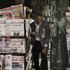 An Egyptian walks past a stand displaying state-owned newspapers in Cairo, Egypt, Tuesday, Dec. 4, 2012. Most independent Egyptian newspapers suspended publication of Tuesday\'s edition in protest over the hurried drafting of the country\'s new constitution adopted by an Islamist-led panel. The media protest involved at least eight influential dailies and was part of a planned campaign of civil disobedience that could bring in other industries and build on an ongoing strike by Egypt\'s judges. (AP Photo/Nariman El-Mofty)