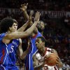 Oklahoma\'s Je\'lon Hornbeak (5) finds Kansas defenders as the University of Oklahoma Sooners (OU) play the Kansas Jayhawks (KU) in NCAA, men\'s college basketball at The Lloyd Noble Center on Saturday, Feb. 9, 2013 in Norman, Okla. Photo by Steve Sisney, The Oklahoman