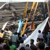 Rescue workers use clothes to bring down survivors and bodies after an eight-story building housing several garment factories collapsed in Savar, near Dhaka, Bangladesh, Wednesday, April 24, 2013. The building collapsed near Bangladesh\'s capital Wednesday morning, killing dozens of people and trapping many more in the rubble, officials said. (AP Photo/ A.M. Ahad)