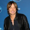 "Photo - FILE - This Jan. 9, 2013 file photo shows Keith Urban at the ""American Idol"" premiere event at Royce Hall on the campus of UCLA in Los Angeles. Urban is a judge on the singing competition series airing Wednesdays and Thursdays on Fox. (Photo by Matt Sayles/Invision/AP, file)"