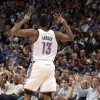 Oklahoma City\'s James Harden (13) celebrates a three-point basket during the NBA basketball game between the Oklahoma City Thunder and the Portland Trail Blazers at Chesapeake Energy Arena in Oklahoma City, Sunday, March 18, 2012. Photo by Sarah Phipps, The Oklahoman.