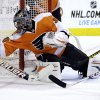 Philadelphia Flyers goalie Ilya Bryzgalov, left, of Russia, dives to cover up the puck as Florida Panthers\' Jerred Smithson looks for the rebound during the first period of an NHL hockey game, Thursday, Feb. 7, 2013, in Philadelphia. (AP Photo/Matt Slocum)
