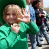 Sierra Dolash, age 4, of Del City, waves to the parade during the St. Patrick\'s Day Parade in downtown Oklahoma City on Saturday, March 14, 2008. By John Clanton, The Oklahoman