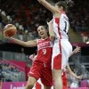 Russia\'s Becky Hammon (9) is defended by Canada\'s Natalie Achonwa, right, during the first half of a preliminary women\'s basketball game at the 2012 Summer Olympics, Saturday, July 28, 2012, in London. (AP Photo/Eric Gay)