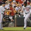 Photo - Washington Nationals' Jayson Werth, right, jogs past third base coach Bob Henley as he rounds the bases after hitting a solo home run in the sixth inning of an interleague baseball game against the Baltimore Orioles, Thursday, July 10, 2014, in Baltimore. (AP Photo/Patrick Semansky)