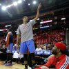 Oklahoma City\'s Thabo Sefolosha points to the scoreboard as he talks with the crowd during Game 6 in the first round of the NBA playoffs between the Oklahoma City Thunder and the Houston Rockets at the Toyota Center in Houston, Texas, Friday, May 3, 2013. Oklahoma City won 103-94. Photo by Bryan Terry, The Oklahoman